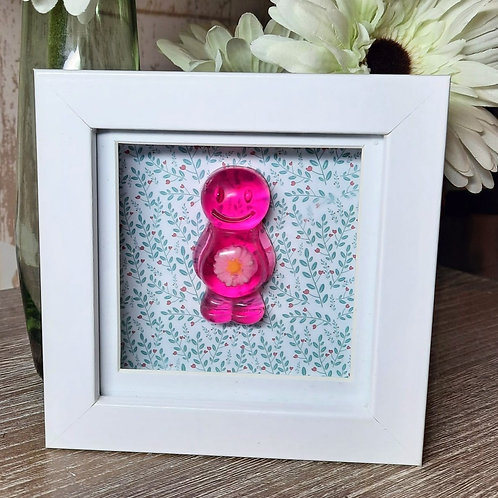 Pink Daisy Jelly Baby With A Floral Background (12x12cm)