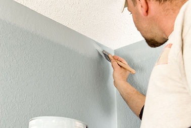 Painter-Cutting-In-Wall-157570457-56a4a0