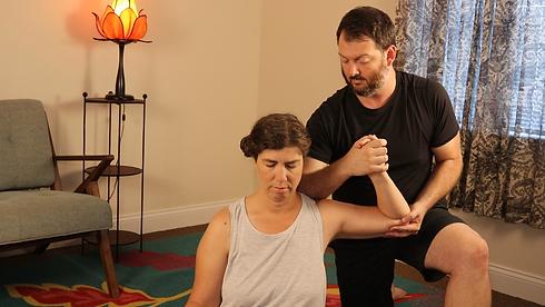 a women is receiving a shoulder massage