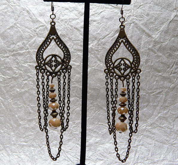 Antique Gold Embellishment and Champagne Beads Make an Intriguing Earring