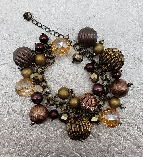 Having Fun with Gold and Bronze Beads - Charm Bracelet