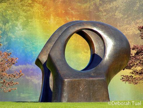 outdoor round sculpture and rainbow