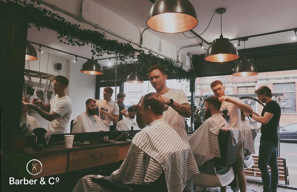 men cutting hair in barber shop vintage