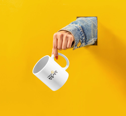 Cup with Hand Mockup.jpg