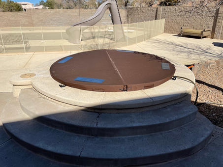 Round in ground DuraCore Solar cover in Albuquerque, New Mexico.