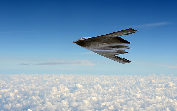 Modern stealth bomber flying at high alt