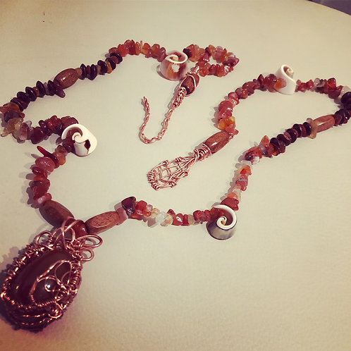 carnelian, wood,and hand wrapped copper and carnelian egg pendant,