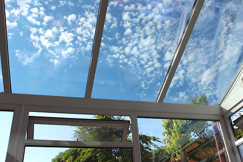 Photo showing a glass conservatory roof with panels of self-cleaning glass. This glass is