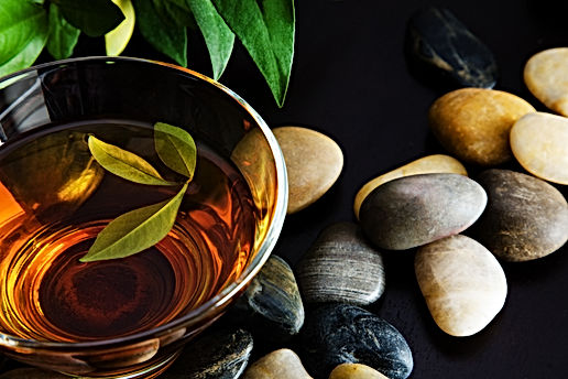 Cup of green tea and pebbles.jpg