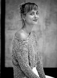 Nora Arnzeder side profile shot in gray