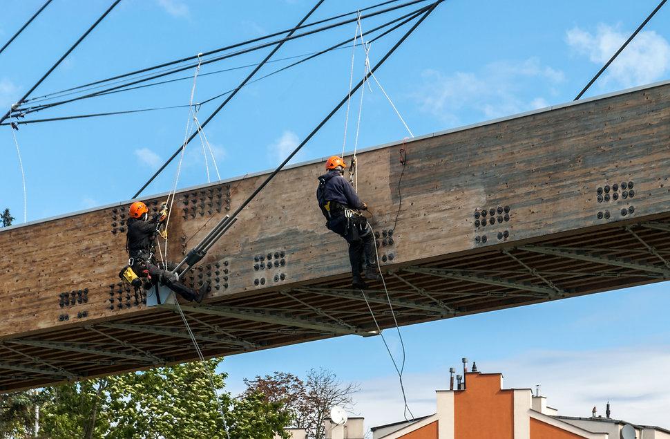 Construction climber on suspension bridg