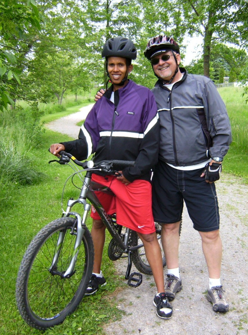 My Dad and I while biking while pregnant with my first born, months before he passed (July, 2009)
