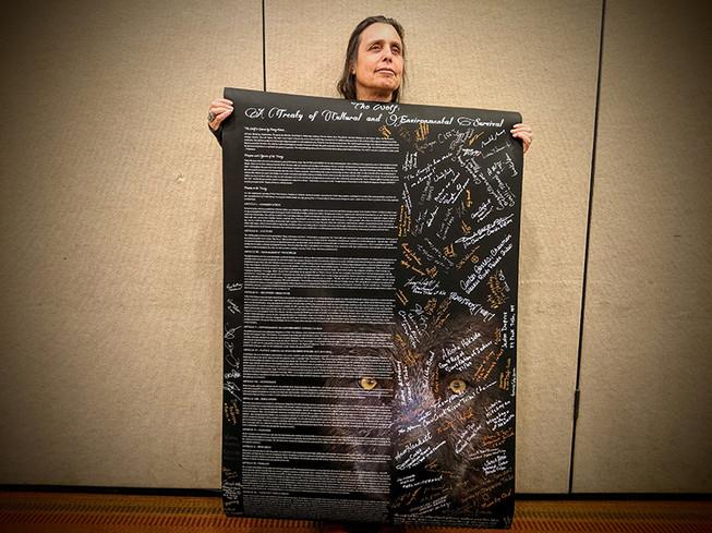 Winona LaDuke holds the Wolf Treaty