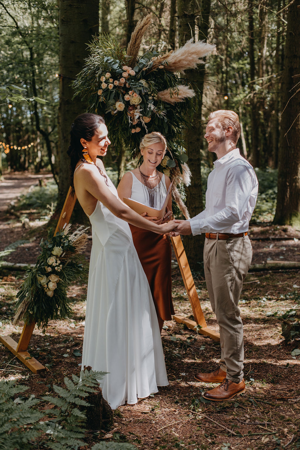 Kent woodland ceremony - celebrant with couple