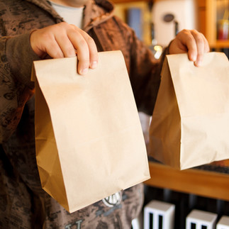 Man holds disposable biodegradable bags.