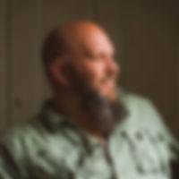 man with green shirt beard.jpg