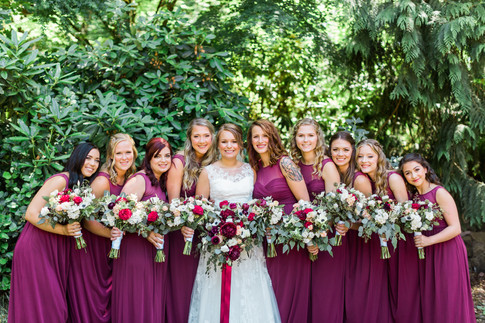 Bride and bridesmaids holding bouquet