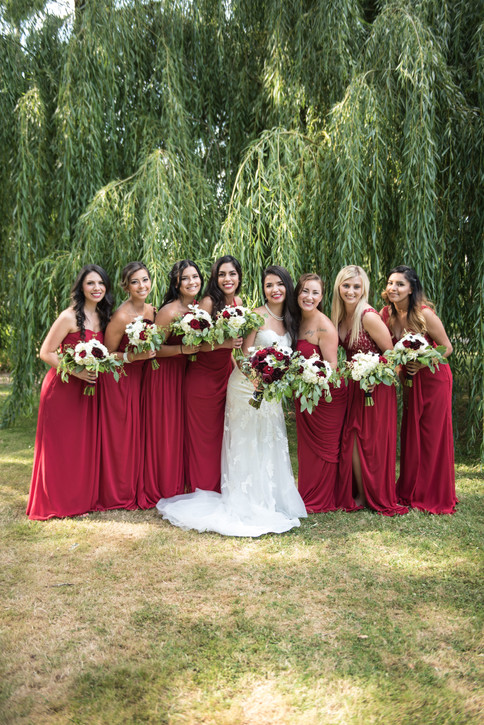 bride and bridesmaid with flowers bouquet