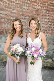 bride and bridesmaid holding bouquet