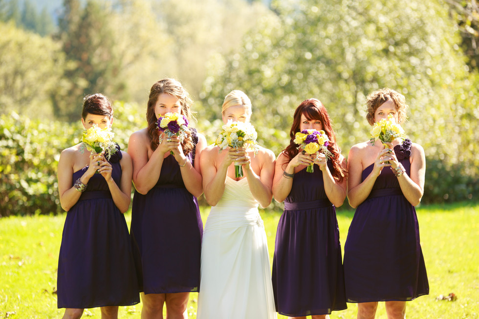 bride and bridesmaid holding flowers bouquet