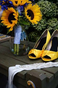 Wedding shoes of the bride together with a bouquet of natural flowers