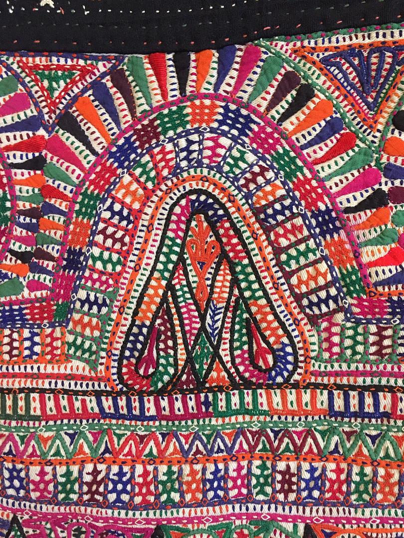 An embroidery detail resembling an A