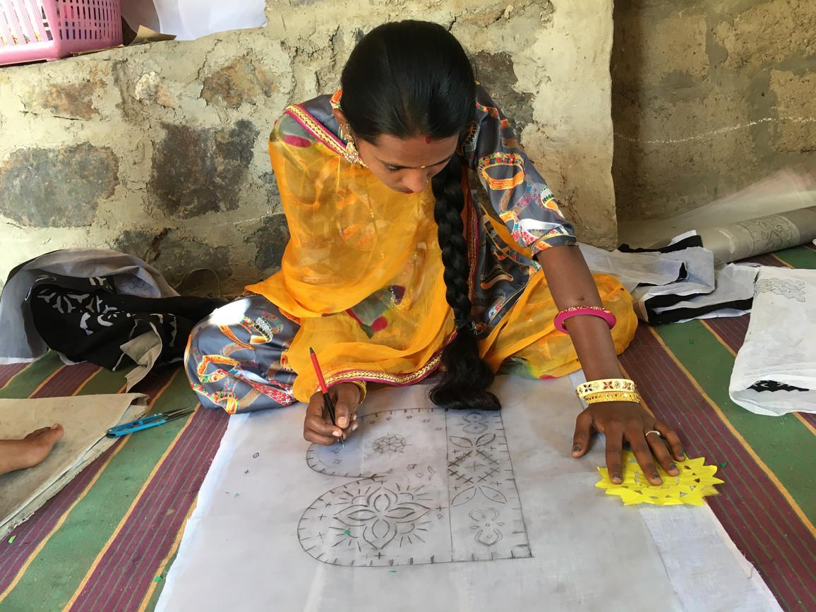 Nirmala working on a design