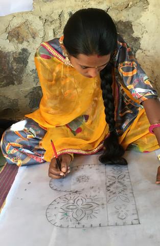 Nirmala designing a B