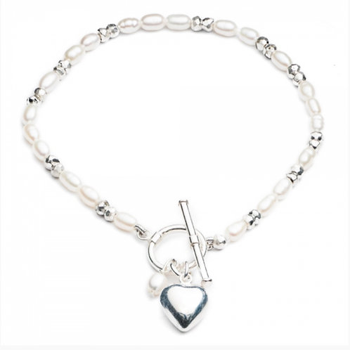 FRESHWATER RICE PEARL BRACELET WITH STERLING SILVER PUFFED HEART CHARM