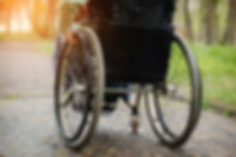 Back view of young woman in  wheelchair