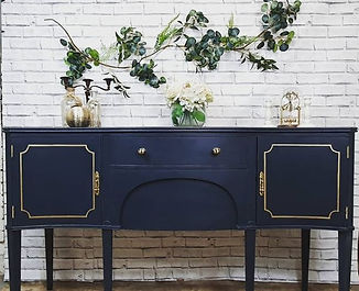 blue cabinet table in front of a white wall