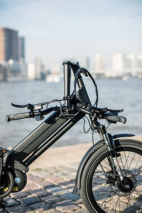 A close-up image of the folded handlebars of the bike.
