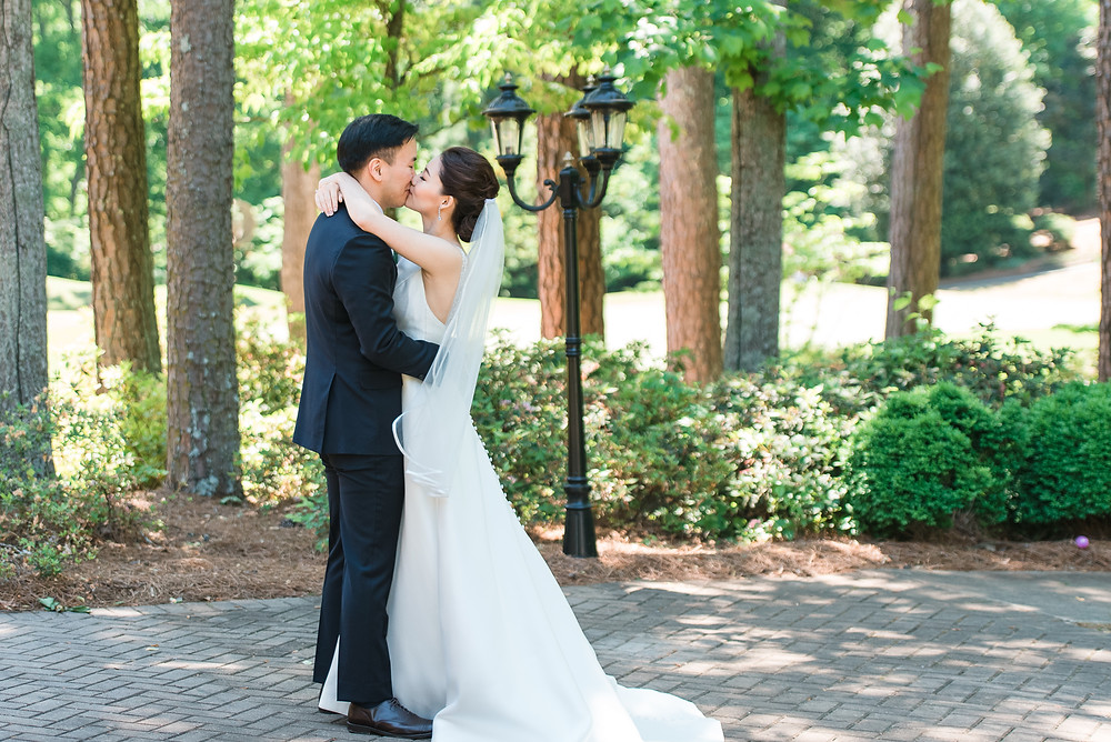 a beautiful couple getting married at the country club of the south