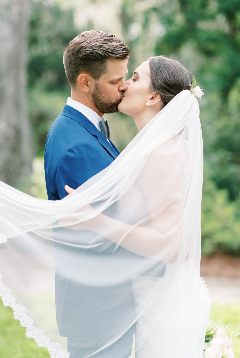 bride and groom kissing ceremony at wesley methodist church st simons island destination wedding