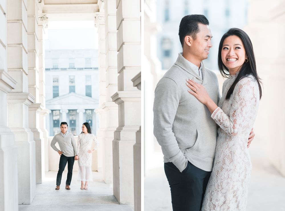 engagement session in downtown atlanta asian couple kissing forehead with white dress and j crew sweater white columns building