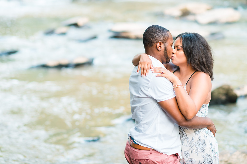 downtown roswell engagement session with beautiful african american couple wearing pink outfit