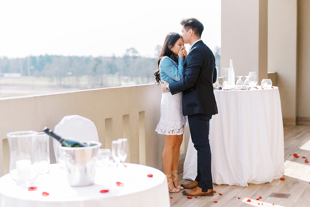 A Surprise Chateau Elan Proposal guy propose to girl with rose petals everywhere
