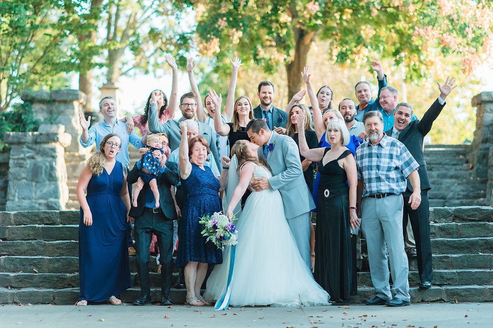 beautiful family cheering for the newlyweds at piedmont park, atlanta ga