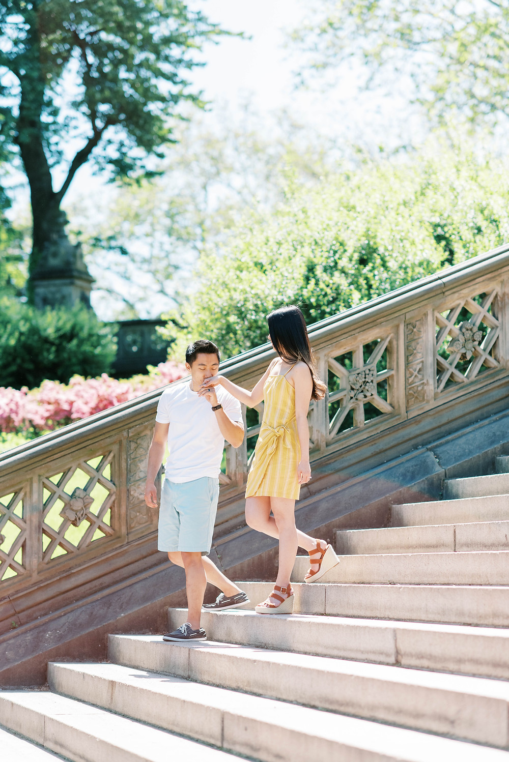 a bride and groom summer engagement session central park new york yellow dress