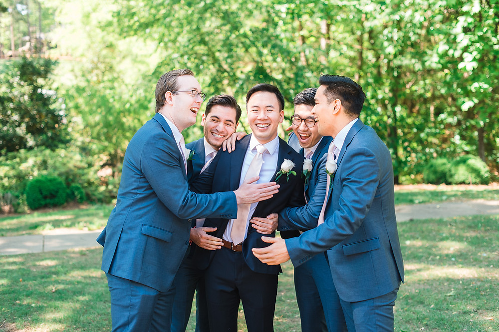 groom and groomsmen in navy stylish tux getting married the country club of the south