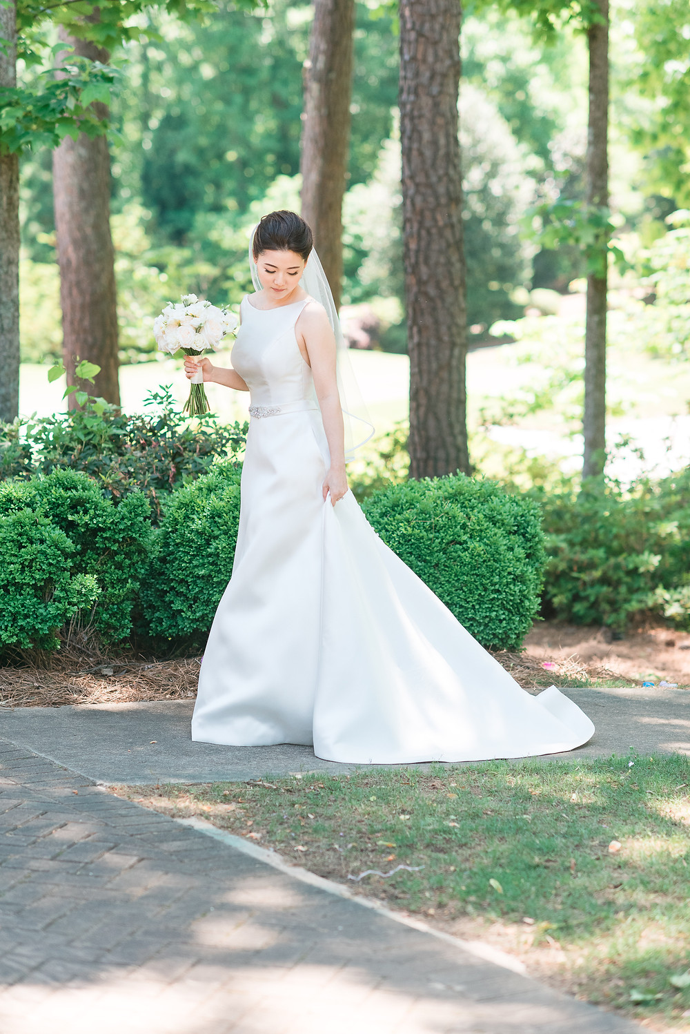 beautiful korean bride wearing a mermaid wedding dress getting married the country club of the south