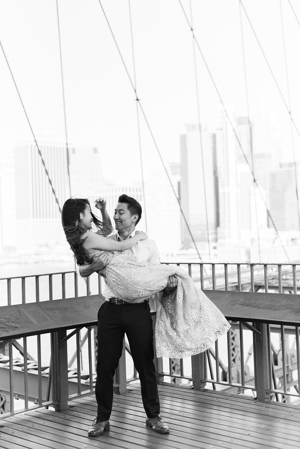 a bride and groom engagement session at brooklyn bridge and central park new york