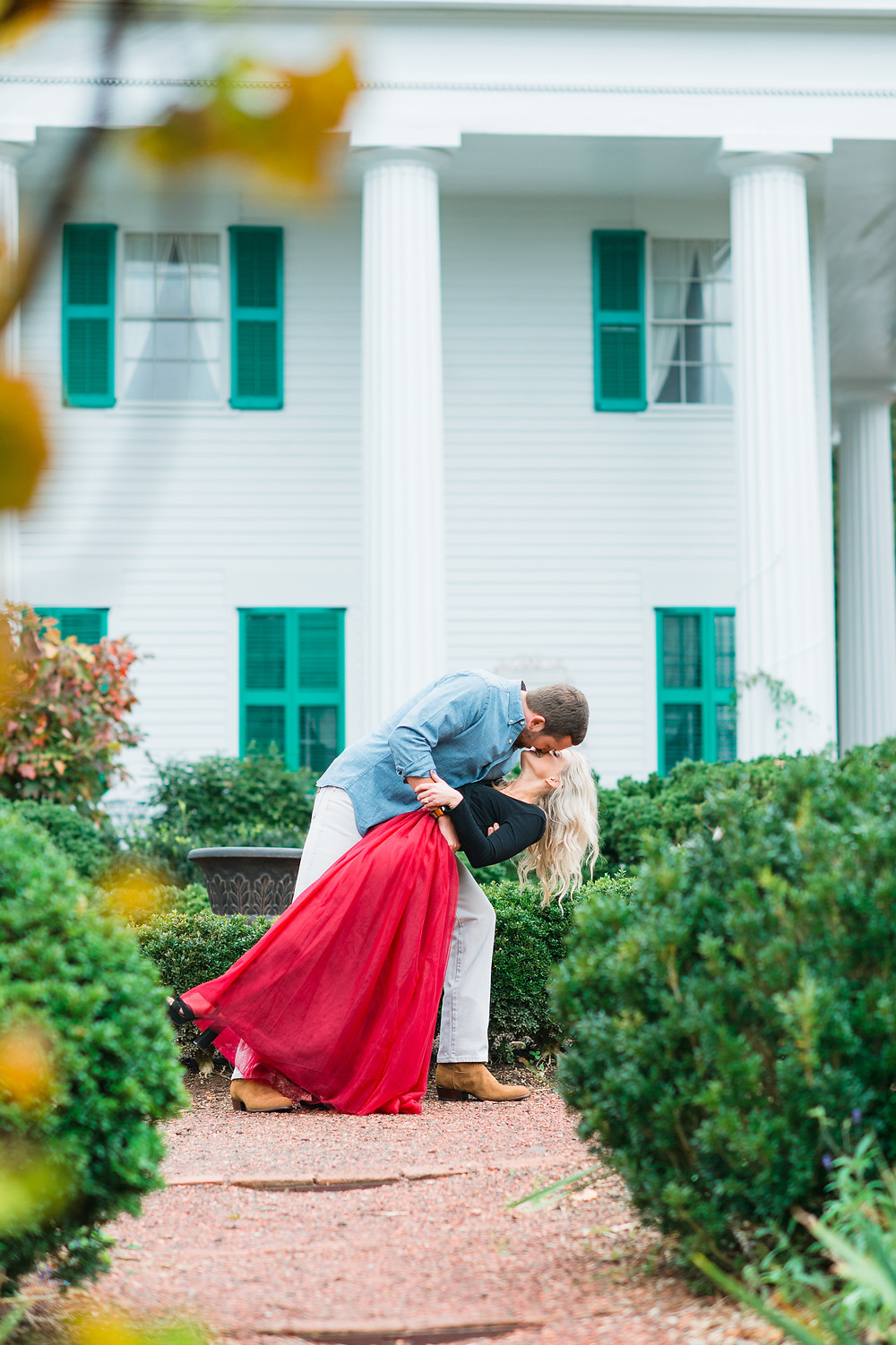 a couple snuggling for a downtown roswell engagement session
