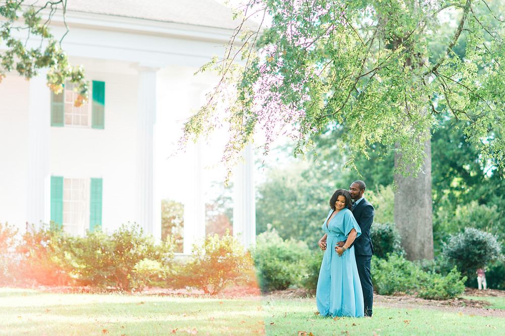 engagement session with a beautiful couple in front of barrington hall, downtown roswell