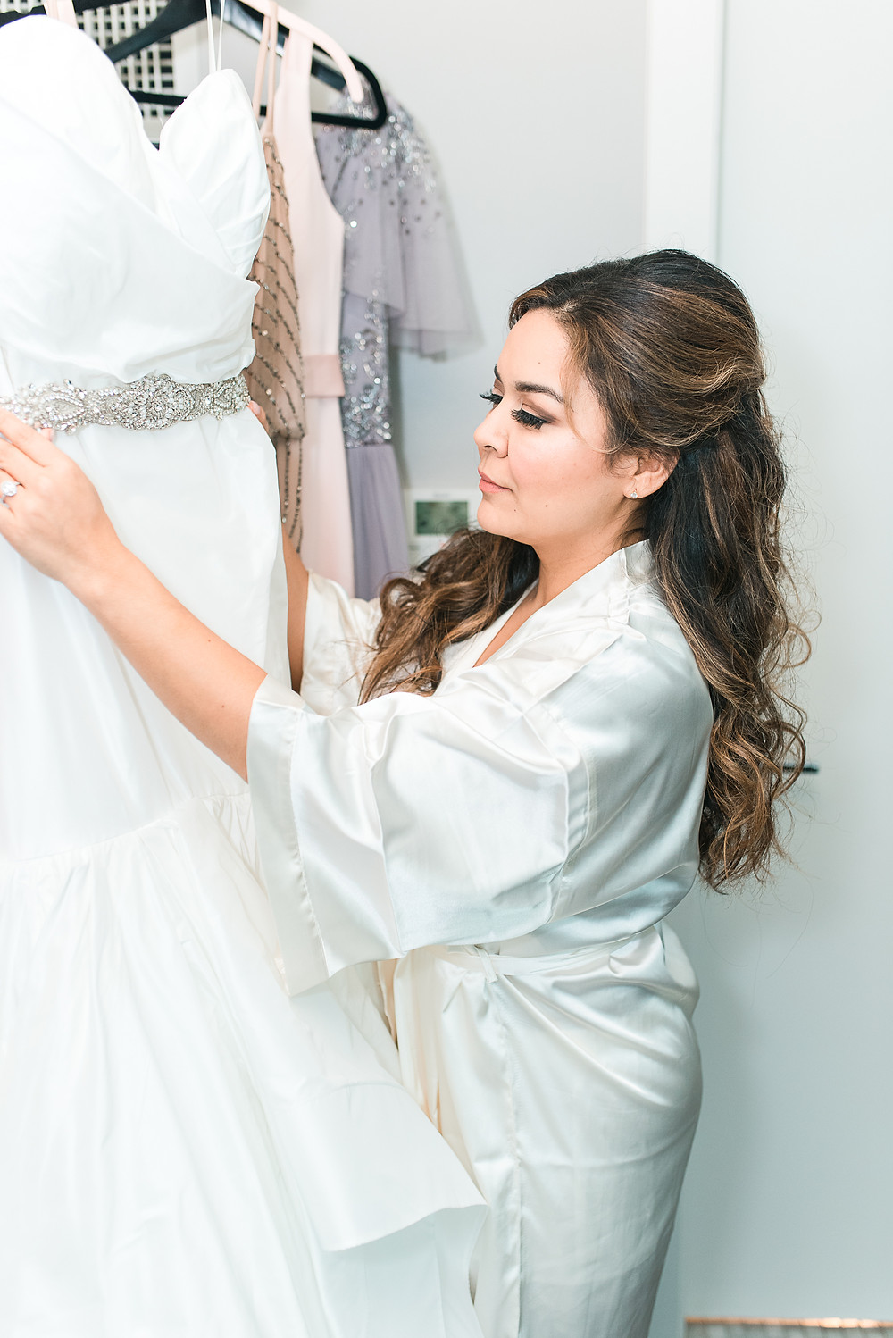 a makeup artist putting the last touch on a bride at W Atlanta BUckhead