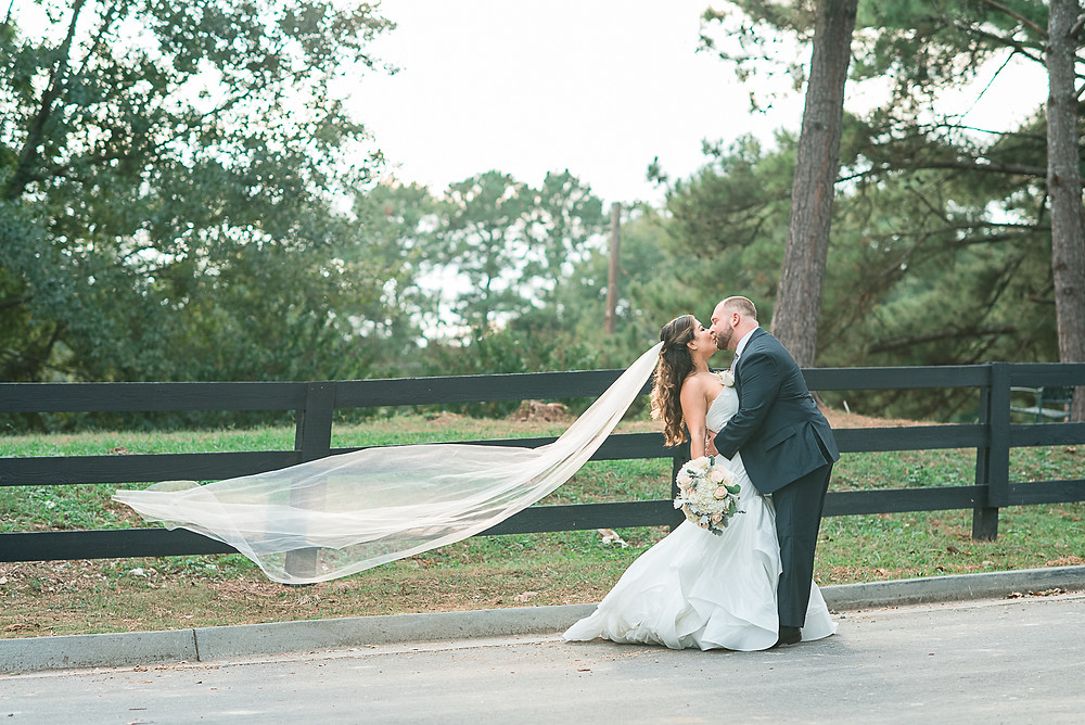 bride and groom holding hand at chastain horse park wedding