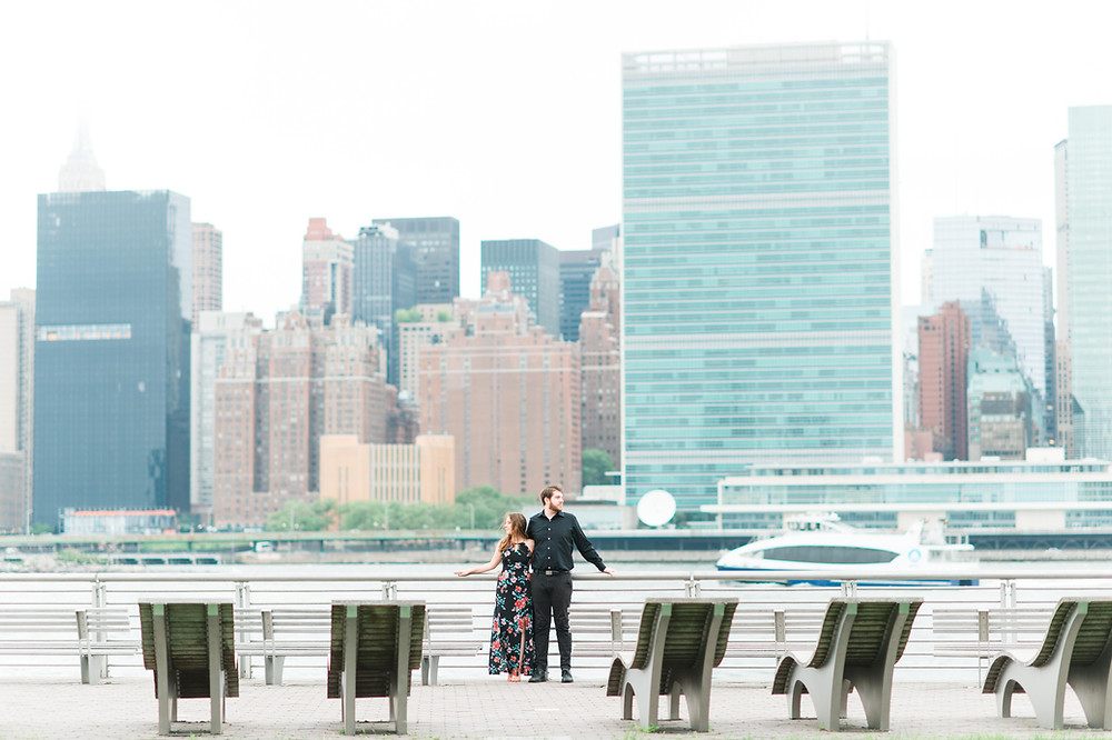 a couple that is so in love in front of NYC skyline kissing at Gantry Plaza State Park