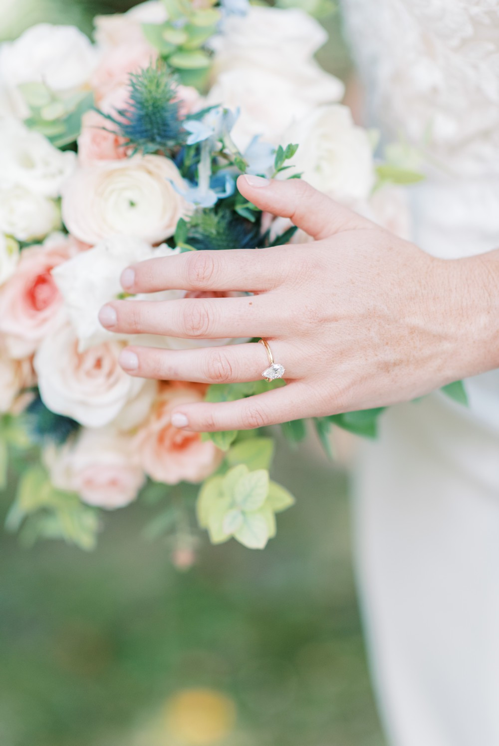 gold ring with a beautiful bridal bouquet st simons island wedding