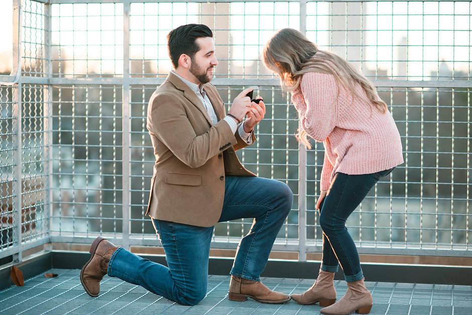 A man-Proposed-She-said-yes-to-a-beautiful-diamondring-WeddingVenue-PonceCity-Roof