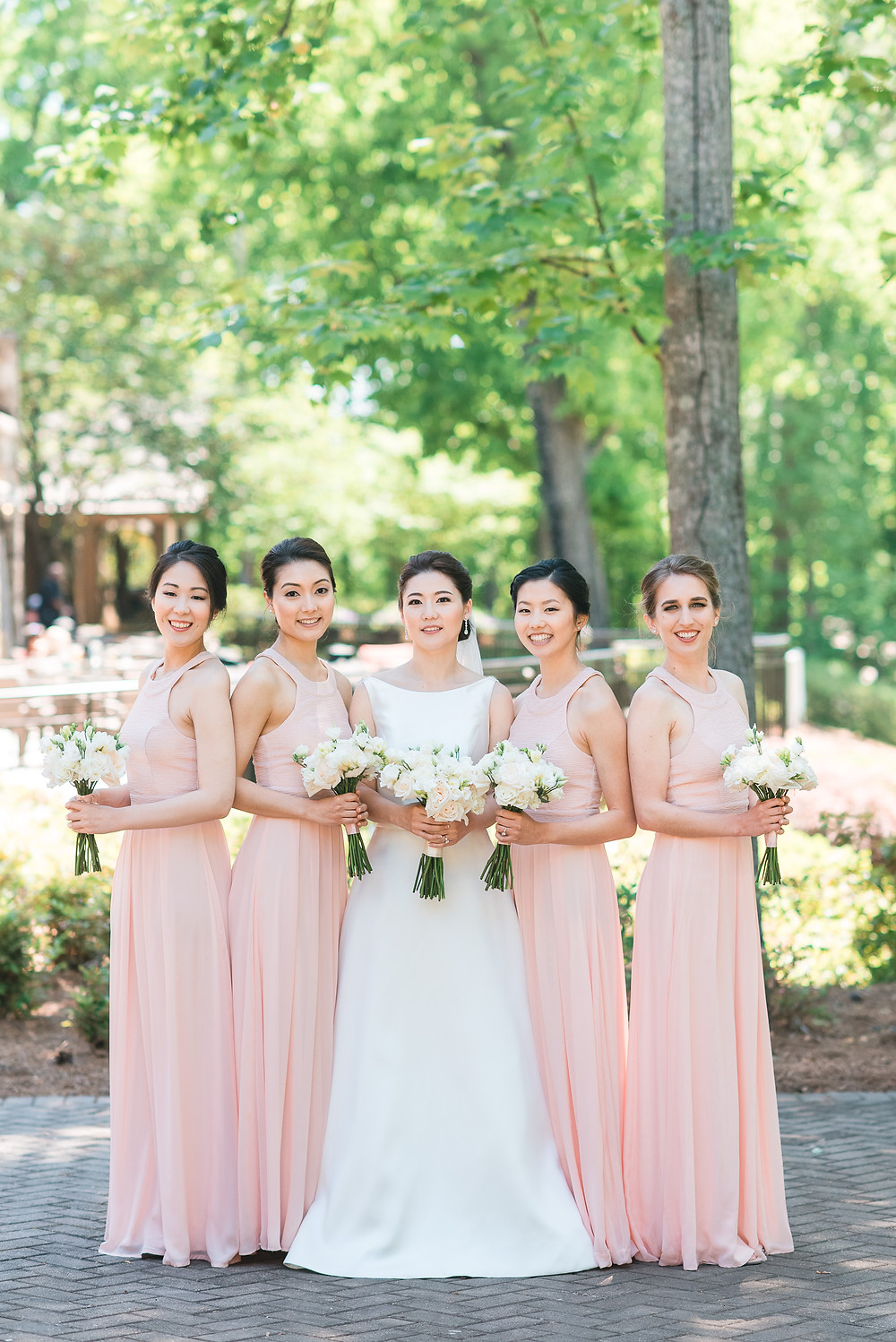 beautiful korean bride and her bridesmaids wearing a blush wedding dress getting married the country club of the south